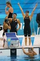 2012 London Olympics -- The Japanese swimming team celebrates after finishing in third place in the women's 400-meter medley relay. From right at poolside are Aya Terakawa, Satomi Suzuki and Yuka Kato, while Haruka Ueda in seen in the pool. (Mainichi/Tsuyoshi Morita)
