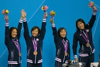 2012 London Olympics -- The Japanese swimming team celebrates on the podium after capturing bronze medals in the women's 400-meter medley relay by setting a new Japan record of 3 minutes, 55.73 seconds. The team also took bronze in the 2000 Sydney Games. From left, Aya Terakawa, Satomi Suzuki, Yuka Kato and Haruka Ueda are seen. (Mainichi/Tsuyoshi Morita)