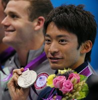 2012 London Olympics -- Japan's Ryosuke Irie shows off the silver medal he earned in the men's 200-meter backstroke. After the medal ceremony he commented,
