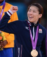 2012 London Olympics -- Japan's Saori Yoshida celebrates on the podium after capturing her third consecutive gold medal in the 55-kilogram division in women's wrestling following the 2004 Athens and 2008 Beijing events. Her winning streak came to an end at the world championships in May but she achieved success again in the London Games.