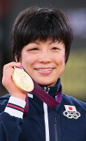 2012 London Olympics -- Japan's Hitomi Obara shows off her gold medal she earned in the 48-kilogram division in women's wrestling. After the competition she said,