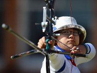 2012 London Olympics -- Japan's Miki Kanie competes on her way to taking the bronze medal in the team event in women's archery. (Mainichi/Ryoichi Mochizuki)