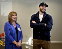 In this Oct. 19, 2019 photo, actor Chris Evans and his mother Lisa Evans, director of the Concord Youth Theatre, laugh inside the theater's new permanent home in Concord, Mass. (Ken McGagh/The Metro West Daily News via AP)