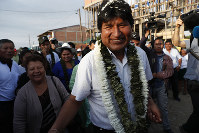 Bolivia's President Evo Morales greets followers before casting his vote in Villa 14 de Septiembre, in the Chapare region, Bolivia, on Oct. 20, 2019. (AP Photo/Juan Karita)