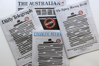 Newspapers display redacted copy on their front pages in Sydney, on Oct. 21, 2019. (AP Photo/Rick Rycroft)