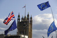 Union Jacks and EU flags fly over Britain's Parliament in London, on Oct. 19, 2019. (AP Photo/Kirsty Wigglesworth)