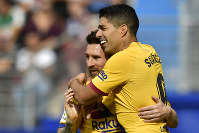 Barcelona's Luis Suarez, celebrates after scoring his side's third goal with Lionel Messi during a Spanish La Liga soccer match between Eibar and FC Barcelona at the Ipurua stadium in Eibar, Spain, on Oct. 19, 2019. (AP Photo/Alvaro Barrientos)