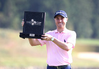 Justin Thomas of the United States poses with his trophy after winning the CJ Cup PGA golf tournament at Nine Bridges on Jeju Island, South Korea, on Oct. 20, 2019. (Park Ji-ho/Yonhap via AP)