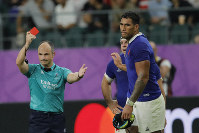 Referee Jaco Peyper shows a red card to France's Sebastien Vahaamahina during the Rugby World Cup quarterfinal match at Oita Stadium in Oita, Japan, on Oct. 20, 2019. (AP Photo/Christophe Ena)