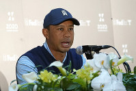 Tiger Woods of the United States answers a reporter's question during a news conference ahead of the Challenge: Japan Skins event at Accordia Golf Narashino C.C. in Inzai, Japan, on Oct. 21, 2019. (AP Photo/Lee Jin-man)