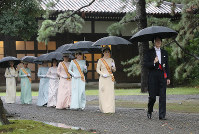 Japan's Crown Prince Akishino, right, followed by Crown Princess Kiko and other members of the Imperial Family, head to the site of a ritual at the Imperial Palace Sanctuaries in Tokyo's Chiyoda Ward on Oct. 22, 2019, prior to the proclamation of Emperor Naruhito's enthronement later in the day. (Pool photo)