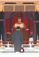 Japan's Emperor Naruhito, rear, proclaims his enthronement to the world as Prime Minister Shinzo Abe bows during a ceremony called Sokuirei-Seiden-no-gi, at the Imperial Palace in Tokyo's Chiyoda Ward, on Oct. 22, 2019. (Pool photo)