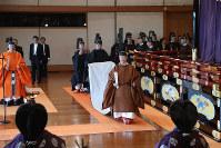 Japan's Emperor Naruhito walks in the