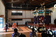 Japan's Emperor Naruhito, right, delivers a speech to proclaim his enthronement from the Takamikura imperial throne in the