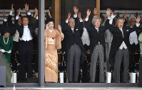 From right in the front row, former prime ministers Yoshiro Mori, Junichiro Koizumi and Yasuo Fukuda give three