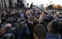 Attorney Joe Rice, center, speaks to the media outside the U.S. Federal courthouse on Oct. 21, 2019, in Cleveland. (AP Photo/Tony Dejak)