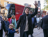 Canadian Prime Minister and Liberal leader Justin Trudeau arrives at the polling station with his son Hadrian, his wife Sophie and daughter Ella-Grace in Montreal, on Oct. 21, 2019. (Paul Chiasson/The Canadian Press via AP)