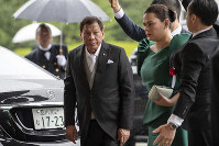 Philippines President Rodrigo Duterte arrives to attend the enthronement ceremony of Emperor Naruhito at the Imperial Palace in Tokyo, on Oct. 22, 2019. (Carl Court/Pool Photo via AP)