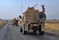 A U.S. military convoy arrives near Dahuk, Iraq, on Oct. 21, 2019. (AP Photo)
