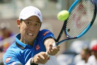 Japan's Kei Nishikori is pictured in acion against Australia's Alex de Minaur in his U.S. Open third-round match in New York on Aug. 30, 2019. (Kyodo)