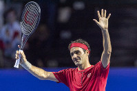 Switzerland's Roger Federer acknowledges the crowd after winning his first round match against Germany's Peter Gojowczyk at the Swiss Indoor tennis tournament at the St. Jakobshalle in Basel, Switzerland, on Oct. 21, 2019. (Georgios Kefalas/Keystone via AP)