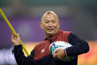 England's coach Eddie Jones throws a training pole during a training session in Oita, Japan, on Oct. 18, 2019. (AP Photo/Christophe Ena)