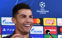 Juventus' Cristiano Ronaldo meets the media ahead of Tuesday's Champions League group D soccer match against Lokomotiv Moscow, at the Allianz stadium in Turin, Italy, on Oct. 21, 2019. (Alessandro Di Marco/ANSA via AP)