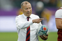 England's coach Eddie Jones gestures ahead of the Rugby World Cup quarterfinal match against Australia at Oita Stadium in Oita, Japan, on Oct. 19, 2019. (AP Photo/Christophe Ena)
