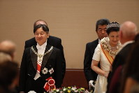 Japan's Emperor Naruhito and Empress Masako are seen at the Kyoen-no-gi banquet at the Imperial Palace in Tokyo on Oct. 22, 2019. (Pool photo)