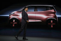 Kunio Nakaguro, executive vice president for Nissan Motor Corp., speaks during Nissan's presentation of the media preview of the Tokyo Motor Show, on Oct. 23, 2019, in Tokyo. (AP Photo/Kiichiro Sato)