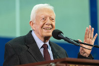 In this Sept. 18, 2019, file photo former President Jimmy Carter acknowledges a student who's question has been picked for him to answer during an annual Carter Town Hall held at Emory University in Atlanta. (AP Photo/John Amis)