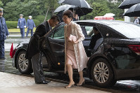 Chief Executive of Hong Kong Carrie Lam arrives to attend the enthronement ceremony of Emperor Naruhito of Japan at the Imperial Palace on Oct. 22, 2019, in Tokyo, Japan. (Carl Court/pool photo via AP)