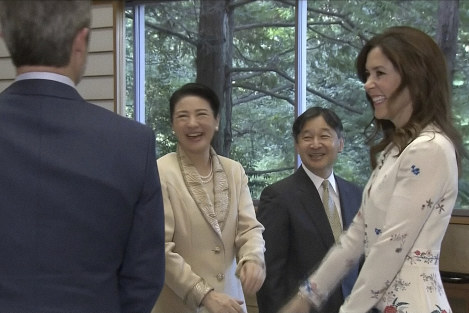 In this image made from video, Japan's Emperor Naruhito, second from right, and Empress Masako, second from left, welcome Crown Prince Frederik and Crown Princess Mary of Denmark for a tea party at the Imperial Palace in Tokyo, on Oct. 23, 2019. (Pool via AP)