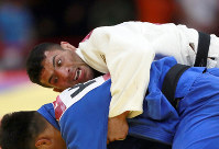 In this Aug. 30, 2018 file photo, Saeid Mollaei of Iran, top, competes against Didar Khamza of Kazakhstan during their men's - 81kg final judo match at the18th Asian Games in Jakarta, Indonesia. (AP Photo/Tatan Syuflana)