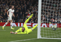 Tottenham's Harry Kane scores his side's fifth goal during the Champions League, group B, soccer match between Tottenham and Red Star Belgrade, at the Tottenham Hotspur stadium in London, on Oct. 22, 2019. (AP Photo/Ian Walton)