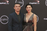 In this July 18, 2018, file photo, LA Galaxy's Servando Carrasco, left, and U.S. women's national soccer team player Alex Morgan arrive at the ESPY Awards at Microsoft Theater in Los Angeles. (Photo by Willy Sanjuan/Invision/AP)