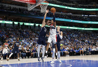 Washington Wizards' Rui Hachimura (8) heads to the basket as Dallas Mavericks' Maxi Kleber (42) and Kristaps Porzingis (6) defend during the first quarter of an NBA basketball game in Dallas, on Oct. 23, 2019. (AP Photo/Tony Gutierrez)