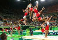 2016 Rio de Janeiro Olympics -- This composite photo shows Japan's Kenzo Shirai successively performing his new twisting technique in the vault in the men's gymnastics to capture the bronze medal. (Mainichi/Masahiro Ogawa)