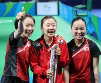 2016 Rio de Janeiro Olympics -- The Japanese women's table tennis team smile after securing the bronze medal by defeating Singapore in the third-place match in the team event. From right, Mima Ito, Ai Fukuhara and Kasumi Ishikawa are seen. (Mainichi/Shin Yamamoto)