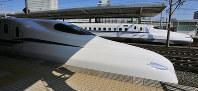 The prototype of the N700S bullet train, foreground, and an N700A train are seen at JR Toyohashi Station in Toyohashi, Aichi Prefecture, on Oct. 30, 2019. (Mainichi/Katsuyuki Uchibayashi)