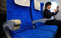 The new N700S model of the Tokaido Shinkansen bullet train is seen equipped with electrical outlets on the armrests of all its seats during a press event to see its interiors on Oct. 30, 2019. (Mainichi/Katsuyuki Uchibayashi)