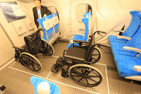 The 11th car of the new N700S model of the Tokaido Shinkansen bullet train is seen with two special spaces for wheelchair users, at a press event to see the interiors of the trains on Oct. 30, 2019. (Mainichi/Katsuyuki Uchibayashi)
