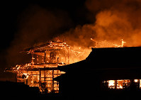 Shuri Castle in the Okinawa Prefecture capital of Naha is seen burning early on the morning of Oct. 31, 2019. (Photo courtesy of Ryukyu Shimpo)