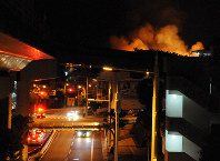 Shuri Castle in the Okinawa Prefecture capital of Naha is seen burning from the Okinawa Urban Monorail's Shuri Station early on the morning of Oct. 31, 2019. (Mainichi/Takayasu Endo)