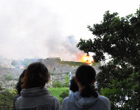 Local residents watch Shuri Castle in the Okinawa Prefecture capital of Naha burning on the morning of Oct. 31, 2019. (Mainichi/Takayasu Endo)