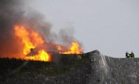 Shuri Castle in the Okinawa Prefecture capital of Naha is seen burning on the morning of Oct. 31, 2019. (Mainichi/Takayasu Endo)