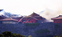 Smoke emerging from Shuri Castle in the Okinawa Prefecture capital of Naha is seen on