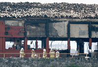Firefighters are seen in front of the Hokuden north hall of Shuri Castle in Naha, Okinawa Prefecture, southern Japan, on Oct. 31, 2019, after it burned down in a fire at the historic World Heritage-listed site earlier in the day. (Kyodo)