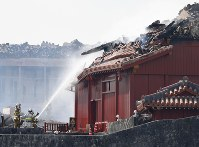 Fire-fighting operations continue at Shuri Castle in Naha, Okinawa Prefecture, southern Japan, on Oct. 31, 2019, after a fire broke out at the historic World Heritage-listed site earlier in the day. (Kyodo)