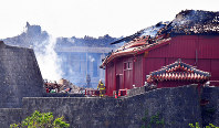 A firefighter is seen amid the ruins of Shuri Castle in the Okinawa Prefecture capital of Naha, on Oct. 31, 2019. (Mainichi/Michiko Morizono)